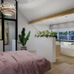Interieurontwerp zolder zicht naar buiten en op badkamergedeelte